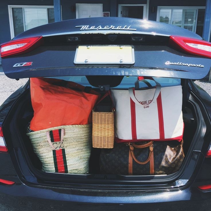 holding-road-trip-essentials Rae Feather bag