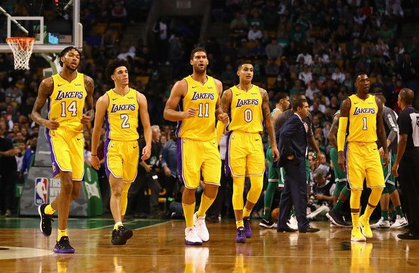 Lonzo Ball Photos - (L-R) Brandon Ingram #14, Lonzo Ball #2, Brook Lopez #11, Kyle Kuzma #0, and Kentavious Caldwell-Pope #1 of the Los Angeles Lakers walk to the bench during a time out in the first quarter against the Boston Celtics at TD Garden on November 8, 2017 in Boston, Massachusetts. - Los Angeles Lakers v Boston Celtics