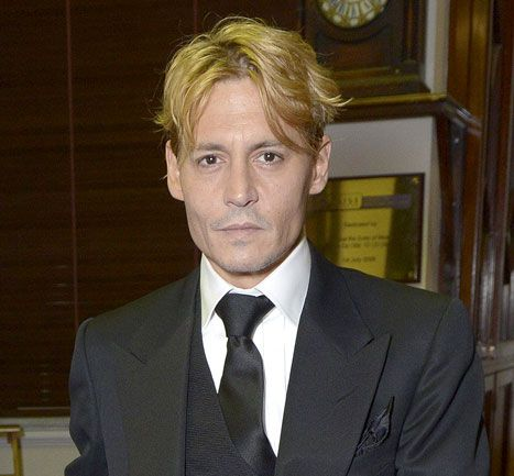 See a photo of Johnny Depp's new bleached blonde hair and tell Us whether the new look is is hot or not.