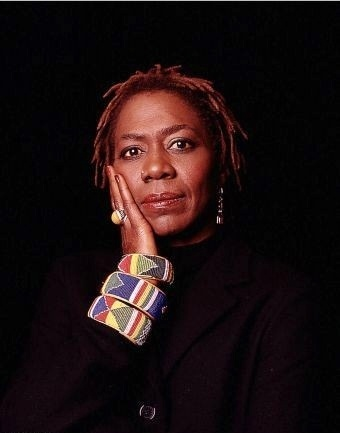 Afeni Shakur Davis (born Alice Faye Williams), American music businesswoman, philanthropist, former political activist & ex-Black Panther. She acted as her own defense attorney after being accused of taking part in numerous bombings as a member of the Panthers. She was the mother of Tupac Shakur, founding the Tupac Amaru Shakur Fdn., Amaru Ent., & Makaveli Branded clothing. She also won a court case against Death Row Records to receive 150 unreleased songs by her son. R.I.P.