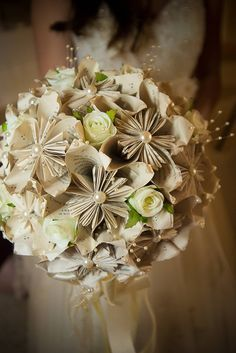 Bridal bouquet made from the pages of a favorite book. (It's so pretty!)