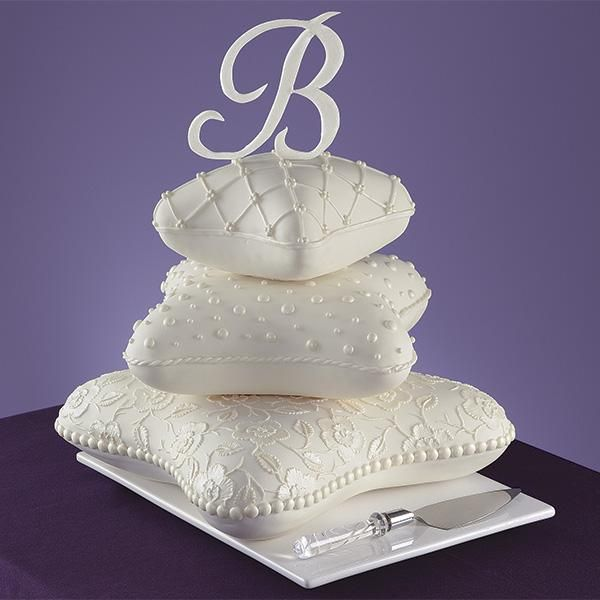 Pillows to Dream On Cake - Sweet dreams will last well into the night with this charming cake design. Each tier is decorated with an assortment of different techniques, including brush embroidery. Initial topper adds a personal touch.