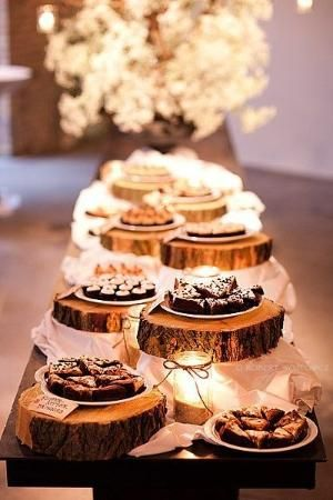 Great idea! Place the wedding reception food or desserts on cut out pieces of wood to add that rustic or country theme. by tamika