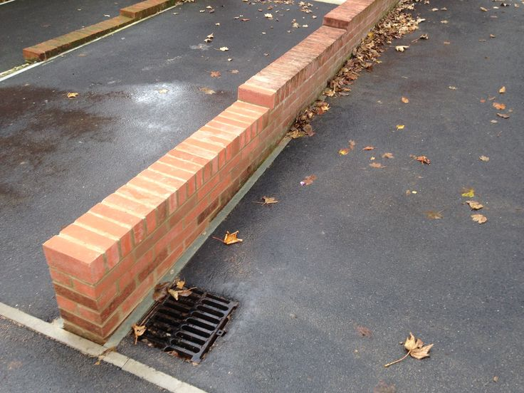 "Low 9"" brick wall for parking bay"