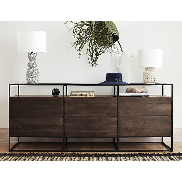 Shop Crawford Low Dresser. Boxy black iron frame holds six floating solid acacia wood drawers and tops off in clear glass. Best of both storage worlds, open shelf dresser displays jewelry/sunnies/accessories while drawers hold everyday essentials.  SIDE TABLE DEN