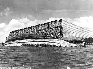 """The USS Oklahoma being righted (or """"parbuckled"""") after the attack on Pearl Harbor"""