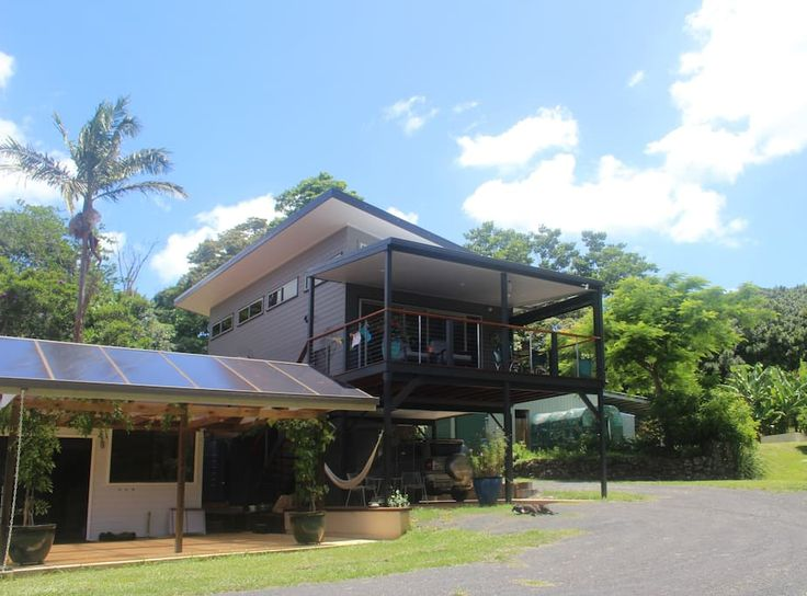 Treehouse in Tintenbar, Australia. Wow features & all modern.  On a rural property with farm animals, creek and macadamia trees.  Beautifully decorated.  Upstairs living with carport underneath. Farmhouse close by. Close to Lennox, Ballina & Byron. Home of local artist. Very ambian...