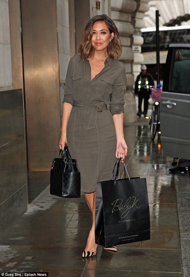 Button up: Myleene Klass wore a trendy shirt dress and contrasting animal print shoes as she headed out in London on Thursday