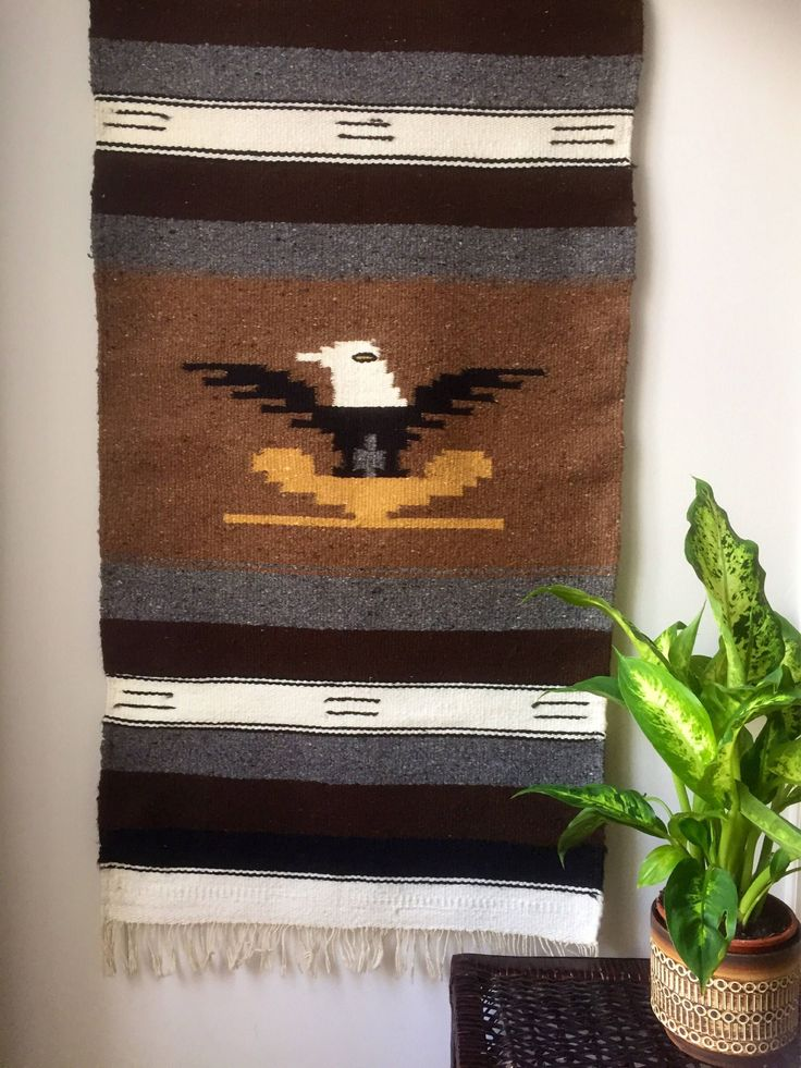 A personal favorite from my Etsy shop https://www.etsy.com/ca/listing/538502318/rustichandwoventapastrywoolwallhangingbo