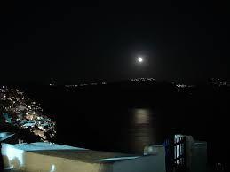 The full moon has just appeared. Oia, Santorini Island, Greece www.oiamansion.com