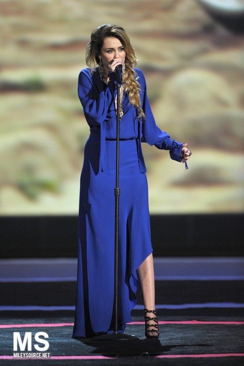 Miley Cyrus Perfomring at The Climb at CNN Heroes tribute in Los Angeles December 12 2011