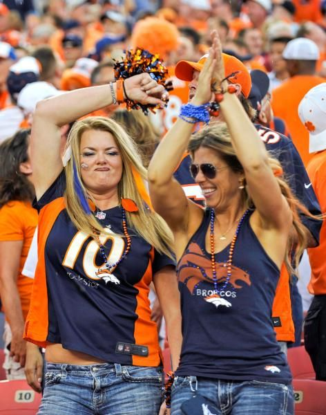 Fans cheer prior to an NFL football game between the ...