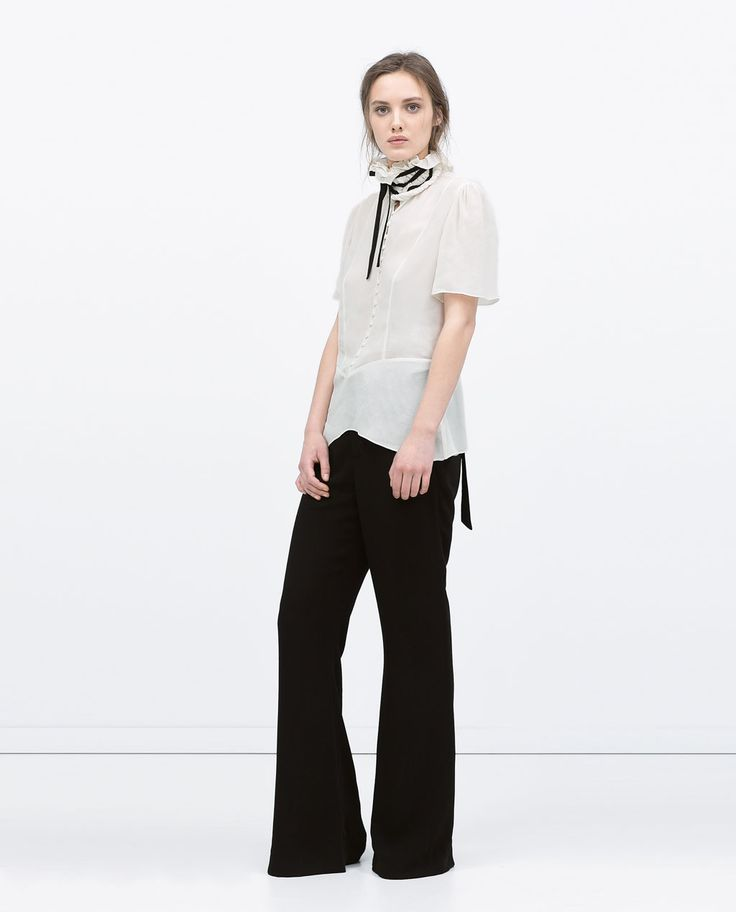 Image 1 of FRILLED TIE NECK BLOUSE from Zara