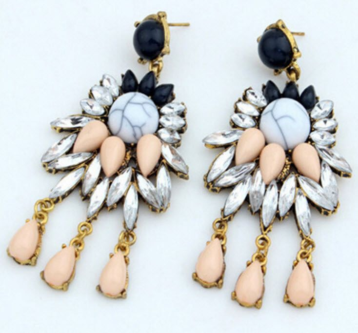 Elena: These earrings are beautifully blended with elements of marble, crystal and pink gems. It compliments pastel colours perfectly and looks very elegant when worn with navy as well.
