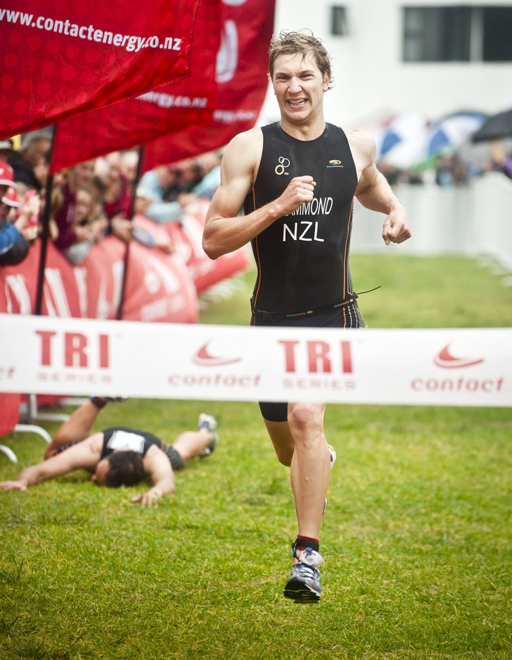 Stephen Sheldrake hits the deck as Hamish Hammond comes through to win the Whangamata round of the Contact Tri Series