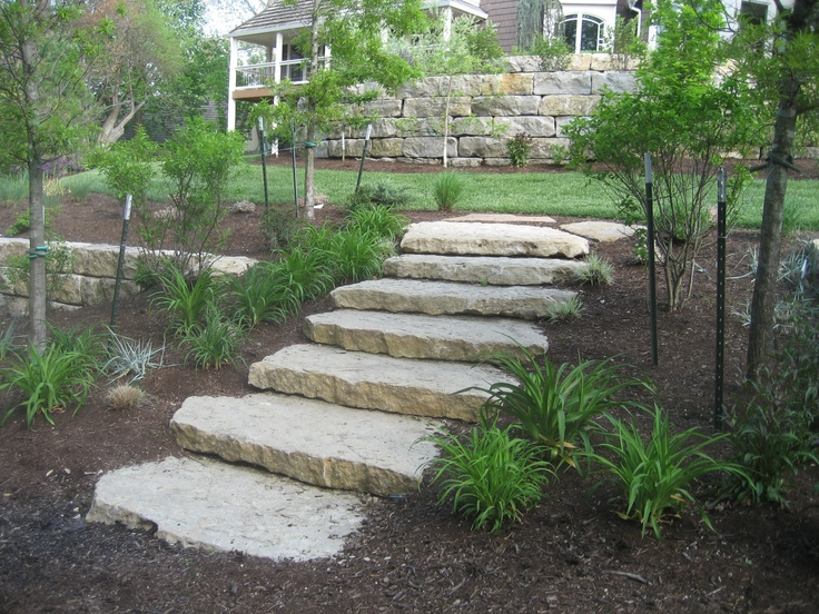Stone Landscape Projects : Ledge stone steps transition between garden terraces
