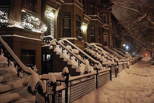 Snow covered Brownstone doorsteps in Boston, Massachusetts.