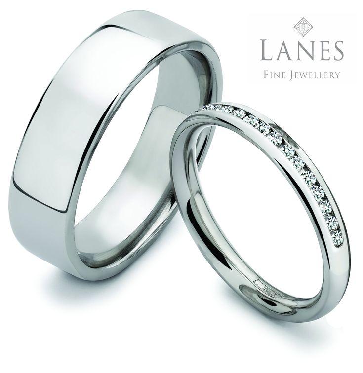 Spectacular Platinum wedding rings Simple elegant design Diamond set for the lady See