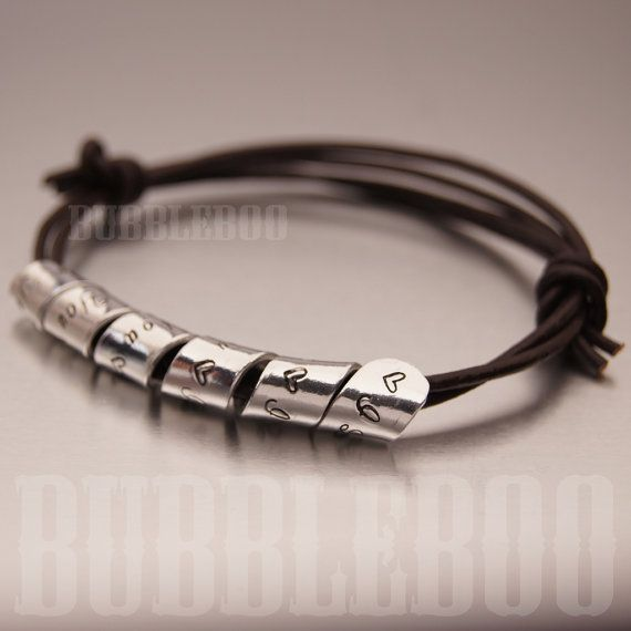 A trendy polished aluminium charm on a tough leather bracelet with a hand-stamped secret message of your choice! We can personalise just for you or as a gift for that special someone!  Your secret message is created from a flat aluminium strip that is hand stamped and twisted into spiral. Say what you like. Its your choice. The adjustable knotted leather bracelet comes in black or brown and should fit everyone.  Made from aluminium which has a much lower likelihood of skin reaction than…