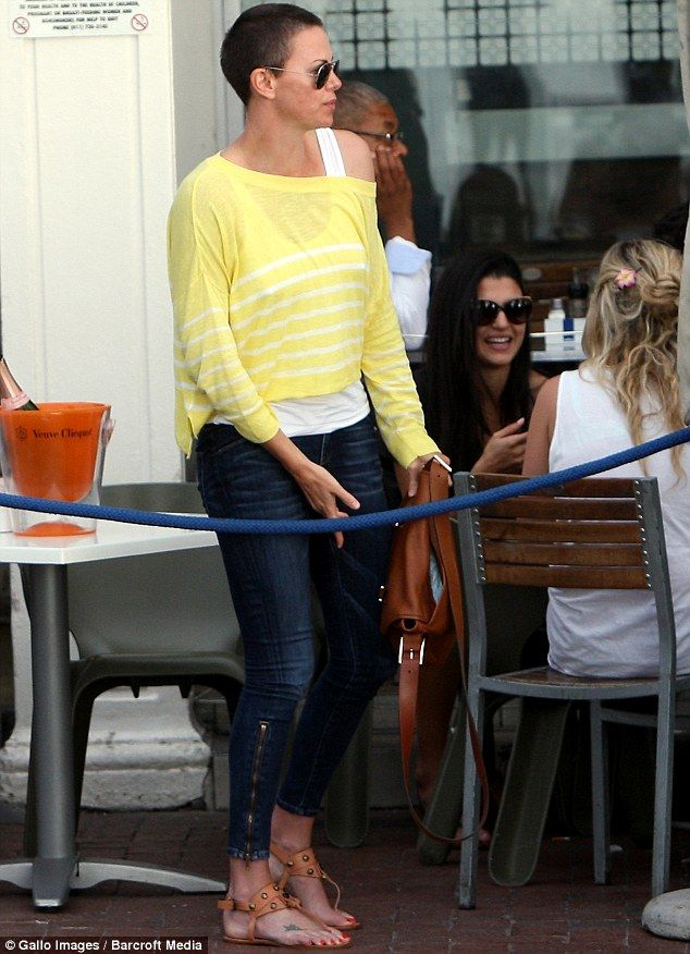 Charlize Theron shows off brunette buzz cut as she lunches with her mother in Cape Town
