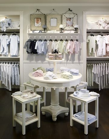 Vintage furniture and built-in casework are combined throughout the store  to showcase baby apparel and accessories in inventive ways.