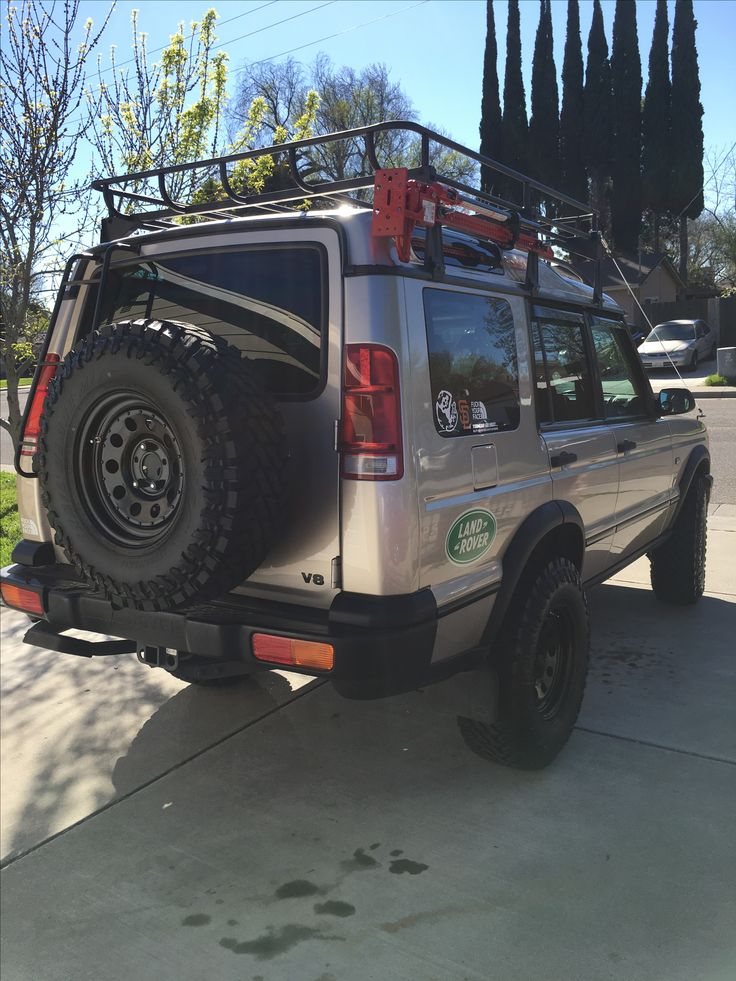 Finally got my 2001 Land Rover Discovery 2 up in the air.  Ladder, tire relocator , rims and tires purchased from lucky8llc.com