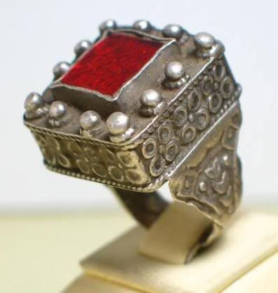 Pashtoun silver ring topped with red glass.