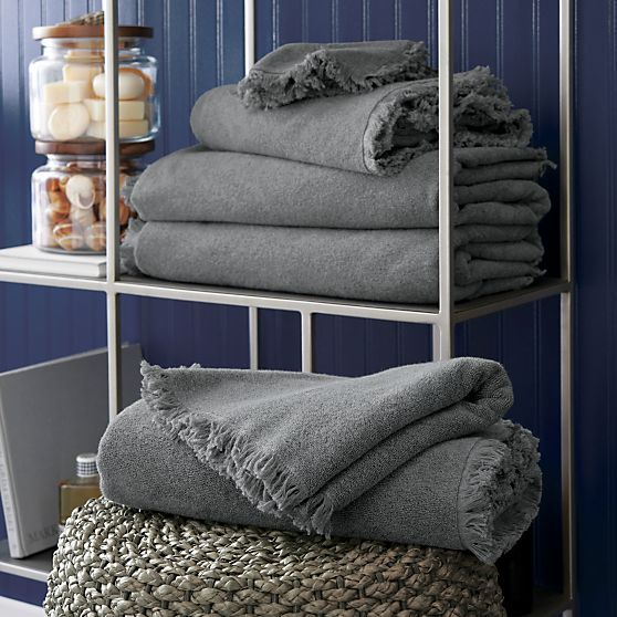 Delicate fringe border and warm grey give the basic bath towel a style upgrade, crafted of plush absorbent cotton.