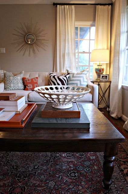 Love the pillows and the decorative bowl!