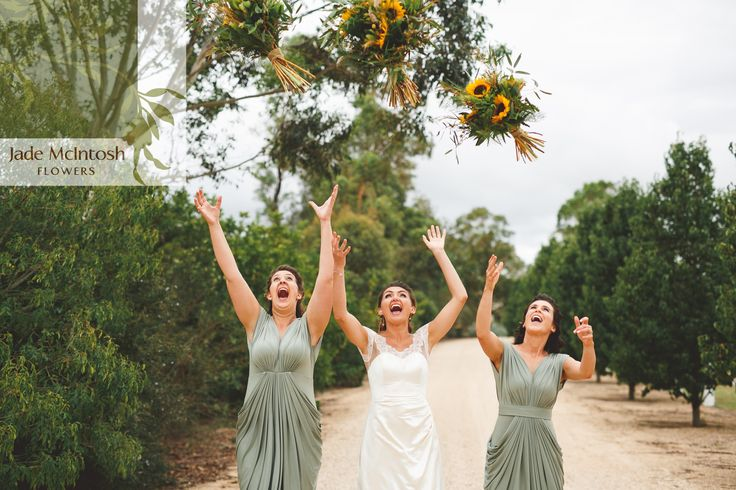 File under: ways to give your wedding florist a heart attack. Thankfully Ellie's summery sunflower bouquets survived just fine. www.jademcintoshflowers.com.au www.littleblackbowphotography.com.au