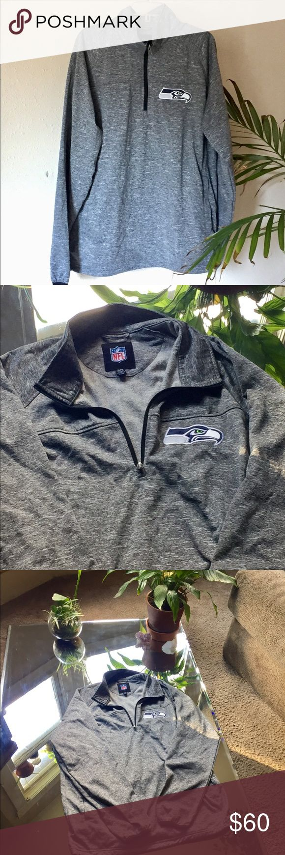 🏈 SEAHAWK PULL OVER 🏈 The in-laws go through Hawk apparel like crayyyy. Very well taken care of! The bottom lining has adjustable elastic which would pair well with Under Armour with the bottom grip (see my closet) for those suppper chilly games. NFL Jackets & Coats