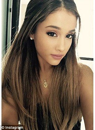 Chains of love: Ariana Grande and rumoured boyfriend Big Sean are definitely acting like a...