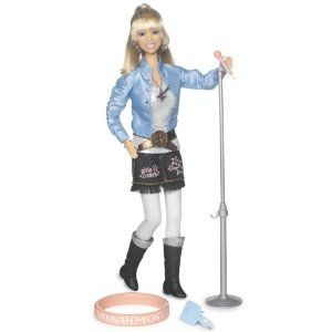 """Hannah Montana """"In Concert Collection"""" Deluxe Singing w/ """"Nobody's perfect"""" by Play Along. $24.99. Includes a tall glow in the dark microphone stand for Hannah to sing. Comes in two different styles sold separately.. Glow in the dark Hannah bracelet for girls matches the glow in the dark bracelet the doll is wearing.. Feel the connection between Hannah and her fans with chart topping songs and infamous phrases from the show.. New Hannah Montana songs and sound bytes....."""