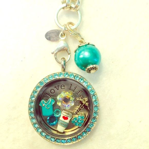 Authentic Origami Owl Nurse inspired Living Locket This beautiful living locket was inspired for the nurses. Comes complete as shown in the photos.   Large silver twist base & face with light turquoise Swarovski crystals, silver custom rolo chain, Aqua pearl dangle, large silver love life plate, and 7 charms.  A must see in person, it is stunning!   Retails over $100. Origami Owl Jewelry Necklaces