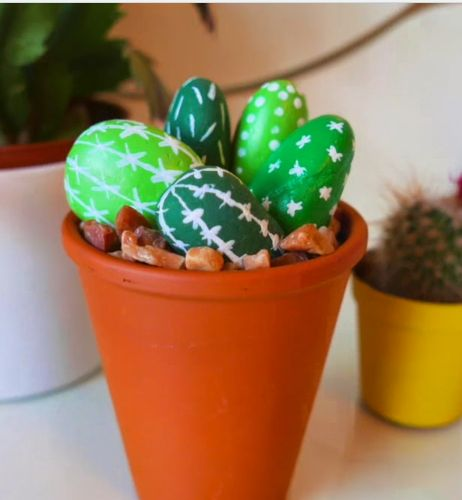 So easy and inexpensive, make this stone cactus display from pebbles!