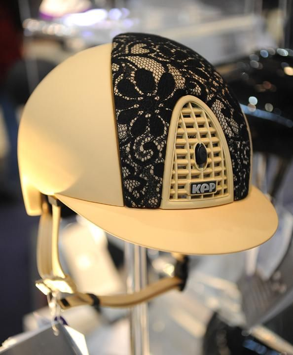 The Italian helmet company Kep added some lace to a cream-colored helmet for an elegant look.Photos  Video | The Chronicle of the Horse #WorldCup #equestrian