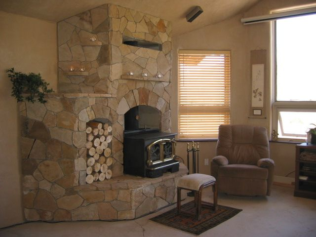 Stone fireplace w/wood stove. love the built in wood storage and small shelf's for candles. don't like the stone needs to be darker. want a more predominate mantle