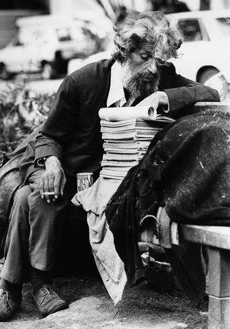 Homeless Man Reading Books | 1977-1998, Tel Aviv-Yafo, Israel --- A homeless man reads from a stack of books on a park bench in Tel Aviv.
