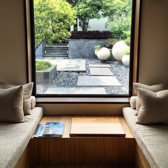 A large window overlooking the garden gives the room natural light at Park Hyatt Ningbo.
