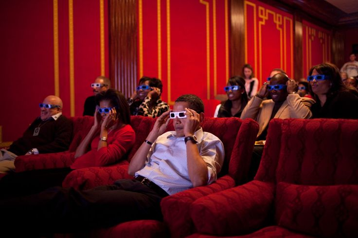 The Obamas and staff wear 3-D glasses while watching a TV commercial during Super Bowl 43, Arizona Cardinals vs. Pittsburgh Steelers, in the family theater of the White House.