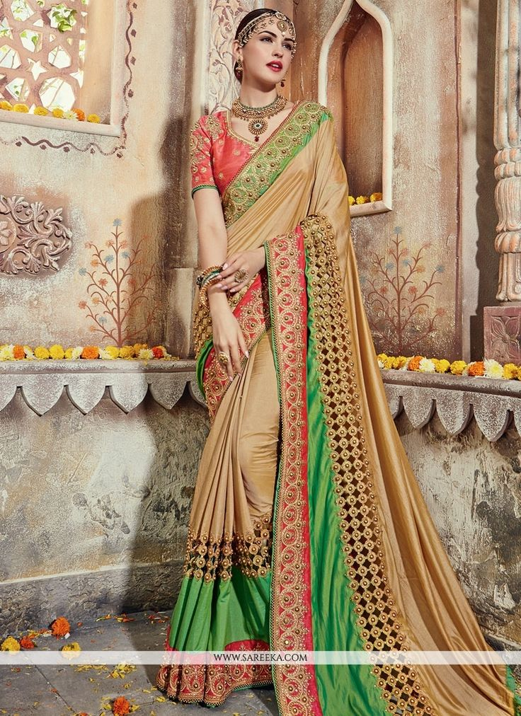 This brilliant array will make you the ultimate classic beauty at the next event you attend. Create a smoldering impact by this beige brasso and georgette designer traditional sarees. This ravishing a...
