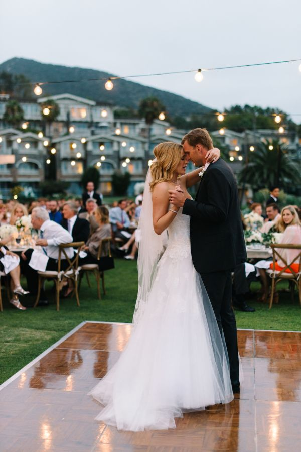 Gorgeous first dance moment: http://www.stylemepretty.com/california-weddings/laguna-beach/2016/05/06/a-gold-medal-worthy-wedding-fit-for-a-five-time-olympic-champion/ | Photography: John Shnack - http://www.johnschnack.com/