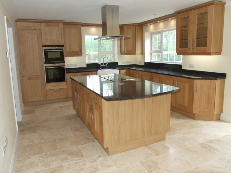 Black granite worktop with cream floor tiles for Kitchen remodel ideas with light oak cabinets