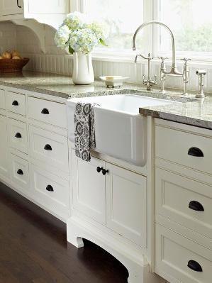 white cabinets, white/gray granite, big over sink window, deep farm sink, backsplash wood detailing by andrea