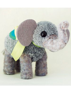 Surprise your kids, or the cute toddler next door, with this #DIY pom pom elephant!! #crafts #kidstoys