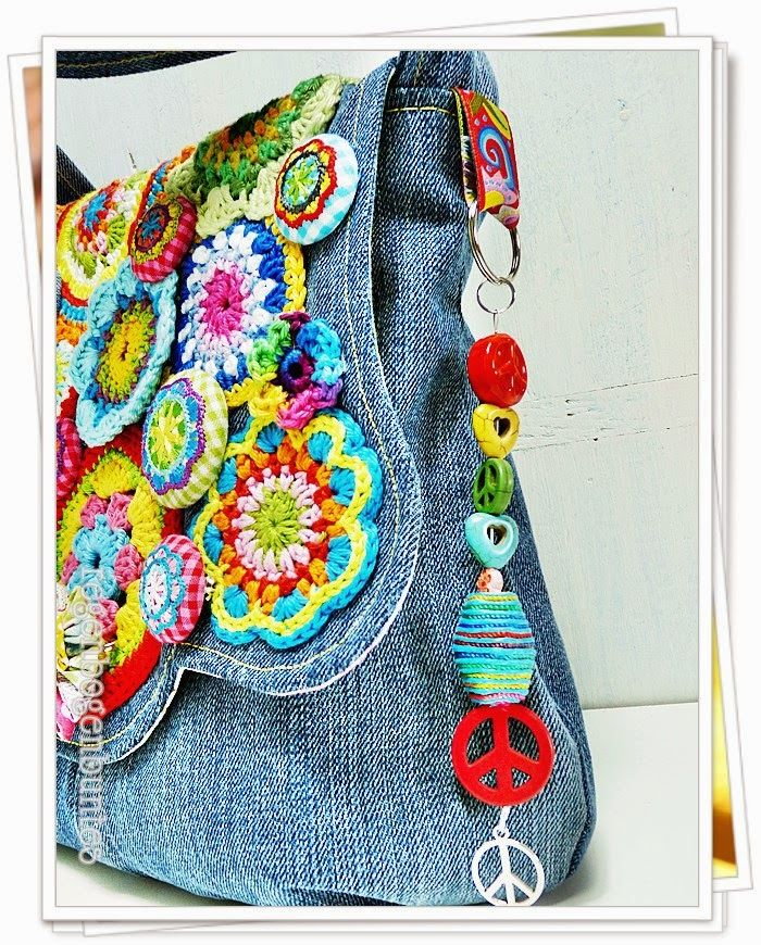 """""""Rainbow colorful"""": Blue jean purse with crocheted flowers.  How's that for some retro """"flower power""""!!"""