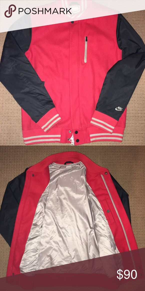 Nike Varsity Jacket Red/black/silver Nike jacket, the red is a soft wool, and the interior is a silk material. Perfect condition. Nike Jackets & Coats Bomber & Varsity