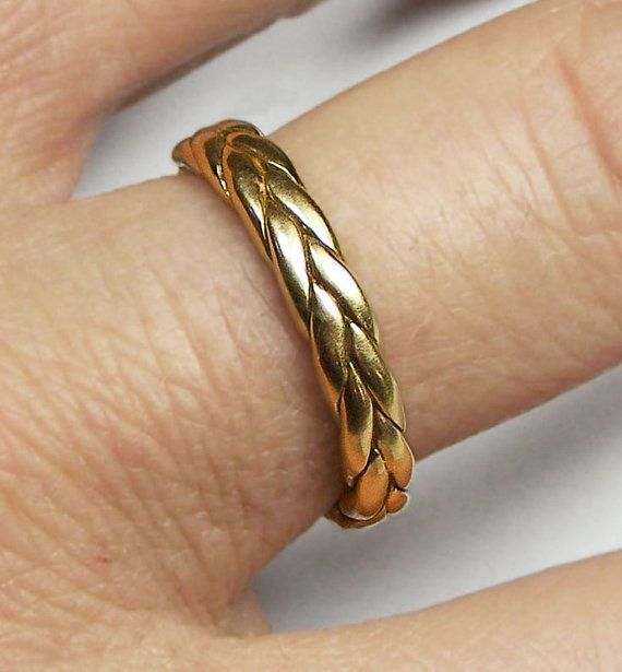 A classic and weighty gold braid ring. Can be a wedding or promise ring or just…