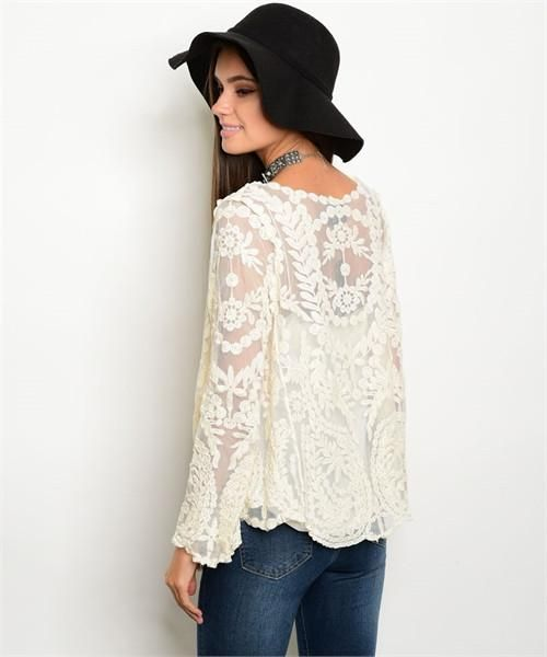 This Boho Chic Lace Cardigan features an open front and gorgeous lace embroidery detailing. We love how this piece can dress up a simple top or dress!