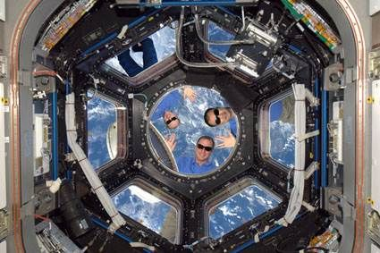 """April Fool in space, 2010. The three-man crew of the International Space Station got a laugh from Mission Control with a photo of themselves spacewalking wearing not space suits, but slacks, T-shirts and sunglasses. (Hope they remembered the sunblock!) They were cosmonaut Oleg Kotov and astronauts Timothy Creamer (USA) & Soichi Noguchi (Japan). Mona Evans, """"Astronomy April Fools"""" http://www.bellaonline.com/articles/art183019.asp: Cosmic Pranks, Spaces Suits, Doctors Photo, International Spaces, Stations Plays, 2010, Spaces Stations, Spacesuit Thursday, April Fools"""